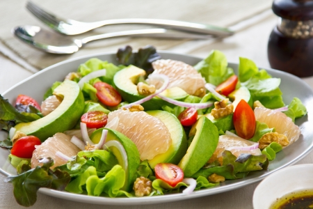 Avocado,Grapefruit and walnut salad photo