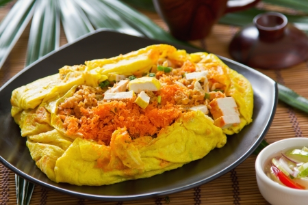 Stir fried wrapped in omelet ,Thai  s food   photo