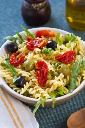 Fusilli with Sun dried tomato and Rocket  salad photo