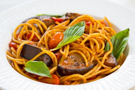 Spaghetti with aubergine ,tomato and basil photo