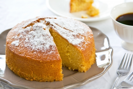 butter icing: Butter cake with orange zest and juice by coffee Stock Photo