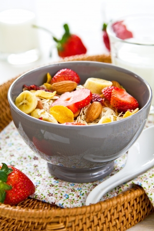 Muesli breakfast with fresh strawberry, almond, cranberries and banana photo