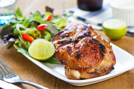 Grilled chicken with lettuce and rocket salad by sour cream dressing photo