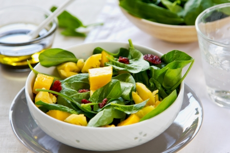 Mango and Pineapple with Spinach and dried cranberries salad Stock Photo