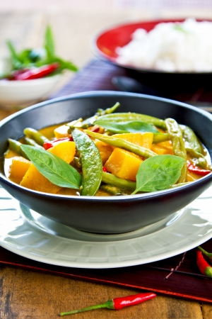 snap bean: Pumpkin with green bean and snap pea red curry Stock Photo