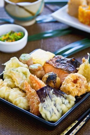 Japanese Bento set contain varieties of vegetables and fish in batter with Nori maki photo