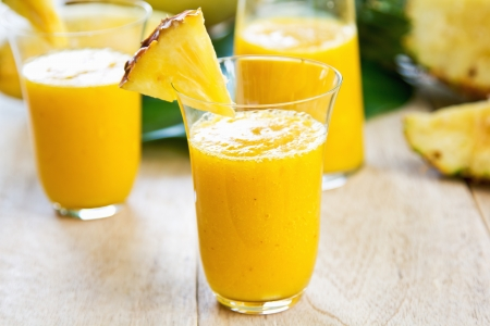 pineapple  glass: Mango with pineapple smoothie  Stock Photo