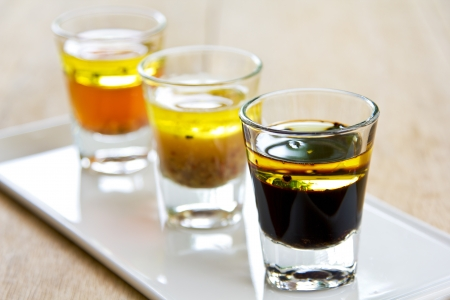 sherry: Varieties of salad dressing in glasses shot