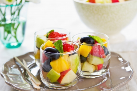 Varieties of fruits salad in small glasses Stock Photo