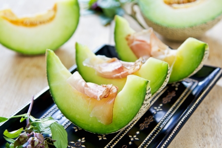 Fresh Melon with Prosciutto and basil photo