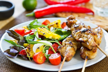 Grilled chicken skewer with grilled vegetables salad photo