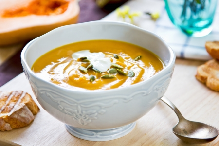 butternut: Butternut squash soup by some toasts Stock Photo