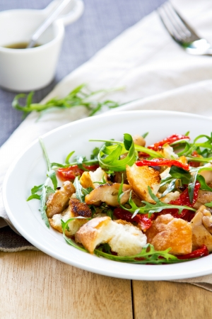 Chicken with sun dried tomato,rocket and crouton salad photo