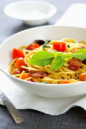 Spaghetti with bacon,tomato and dried chilli photo