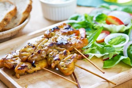 chicken salad: Grilled chicken skewer with salad and yogurt sauce