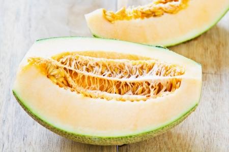 honeydew: Halve Cantaloupe on wood board Stock Photo