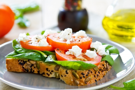Feta and Spinach on pumpkin and sesame bread sandwich photo