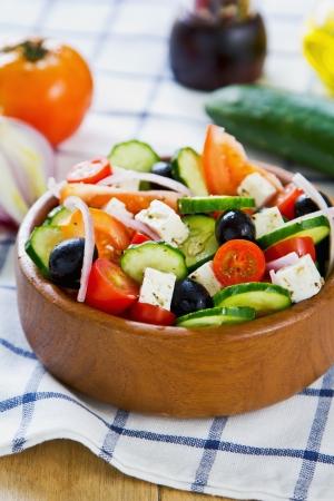greek salad: Greek salad in a wood bowl by fresh ingredients