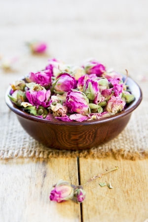 pale wood: Dried rose bud which are used  for tea,cuisine, cosmetic and decoration Stock Photo