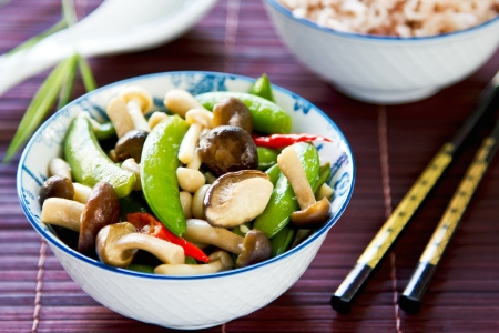 Stirred fried snap pea with mushroom in oyster sauce by brown rice photo