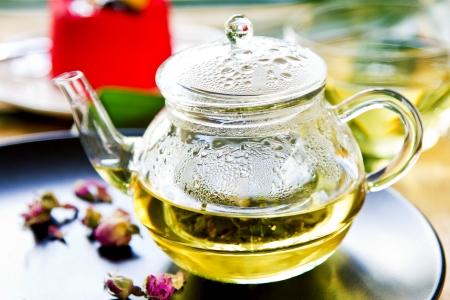 yellow tea pot: Verbena,Mint and Rose buds as mix herbal tea in a tea pot