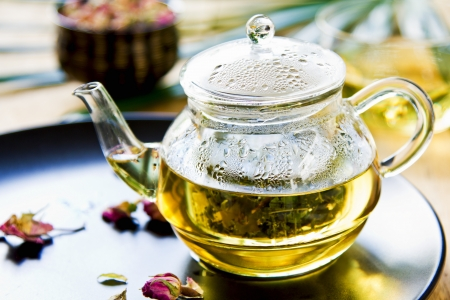 Verbena,Mint and Rose buds as mix herbal tea in a tea pot photo