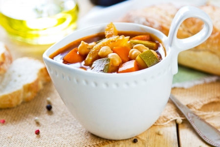 chickpea: Vegetables with Chickpea soup by loaf of bread