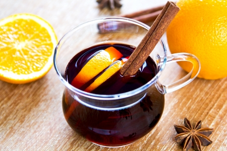 Mulled wine with pieces of orange and spices photo