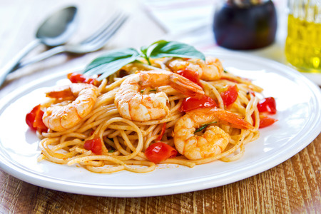 Spaghetti with prawn,cherry tomato and basil photo