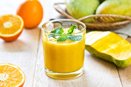 Mango and Orange smoothie by some fresh ingredients photo
