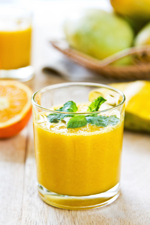 Mango and Orange smoothie by some fresh ingredients Stock Photo