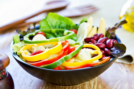 green pea: Colorful Healthy salad by pepper and olive oil Stock Photo