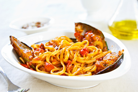 Fettuccine with Mussel in tomato sauce by some sea salt photo