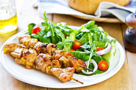 tandoori chicken: Grilled chicken skewer with rocket salad by bread
