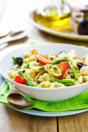 Gnocchi with Asparagus and olive salad in Pesto dressing photo