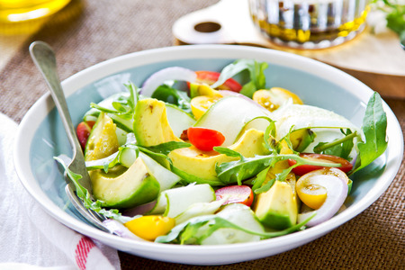 Avocado with Cucumber and Rocket salad by Balsamic dressing photo