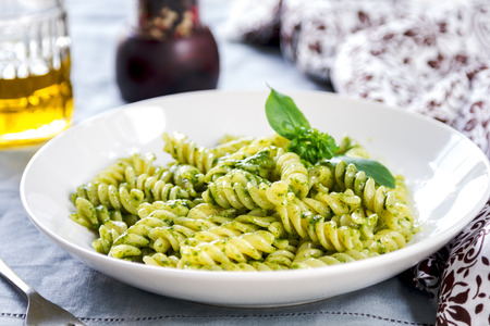 Fusilli in Pesto sauce by   olive oil and peper mill photo