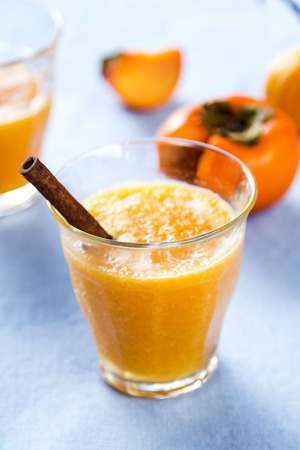 Persimmon with orange smoothie by fresh ingredients photo