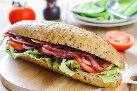 rocket lettuce: Bacon with vegetable on wholemeal and sesame baguette Stock Photo
