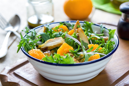 rocket lettuce: Grilled chicken with orange salad by balsamic dressing Stock Photo