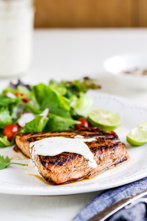 Glazed Salmon with salad by soured cream dressing