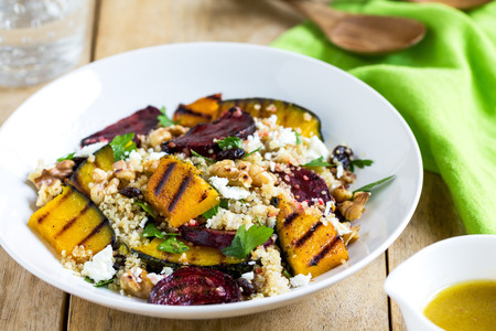 green salad: Quinoa with grilled pumpkin and beetroot salad by vinaigrette Stock Photo