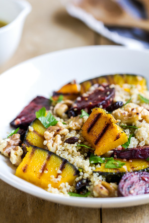 Quinoa with grilled pumpkin and beetroot salad by vinaigrette Stock Photo