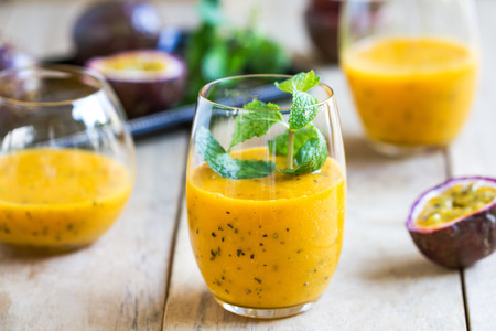 exotic fruits: Mango with Passion fruit smoothie by fresh ingredients Stock Photo