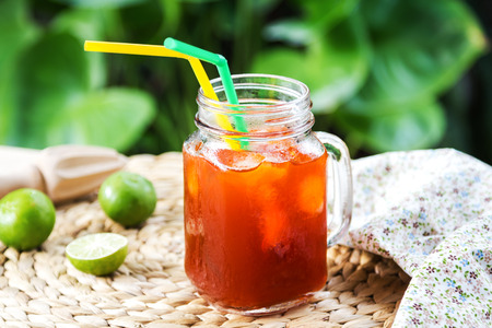 Ice tea with fresh lime by lemon reamer