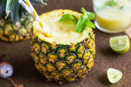 mocktail: Pineapple with Lychee smoothie in fresh Pineapple