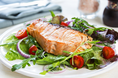 sea food: Grilled Salmon fillet with fresh salad