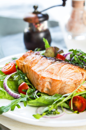 salmon dinner: Grilled Salmon fillet with fresh salad