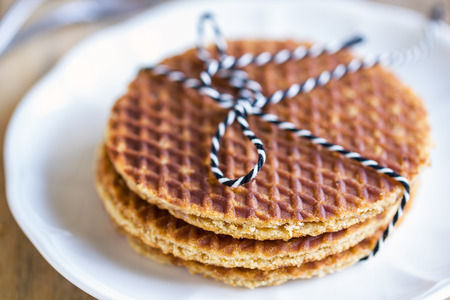 waffle: Strack of Traditional Dutch waffle called Stroopwafel on a dish
