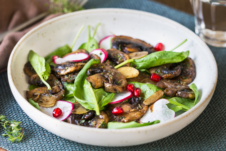 spinach salad: Sauteed Mushroom with Spinach and Pomegranate salad Stock Photo
